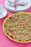 Rhubarb & almond tart on pink table. Short crust pastry with rhubarb and almond Royalty Free Stock Photography