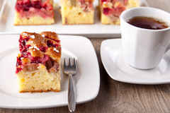 Rhubarb cherry cake. Picture of a rhubarb cherry cake with a cup of tea Stock Image