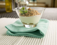 Rhubarb & custard pannacotta with almond crumble Stock Image