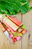 Rhubarb cut with leaf on a wooden board Royalty Free Stock Photos
