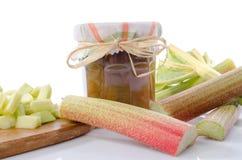 Rhubarb jam jar with fresh rhubarb Royalty Free Stock Image