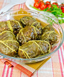Rhubarb leaves stuffed in glass dish on fabric Royalty Free Stock Image