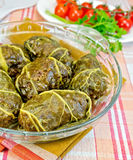 Rhubarb leaves stuffed in glass dish with tomatoes Stock Image