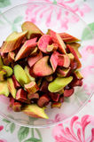 Rhubarb pieces. Fresh rhubarb slices in plastic container Stock Images