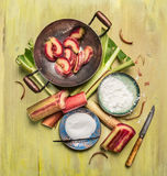 Rhubarb preparation of making jam, marmalade or compote on rustic wooden background Royalty Free Stock Photo