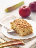 Rhubarb pudding. Homemade crumble pie decorated with fresh rhubarb stems. Royalty Free Stock Photography