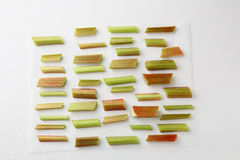 Rhubarb slices on wood  white background Royalty Free Stock Images