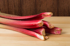 Rhubarb stalks on wooden table Stock Photo