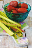Rhubarb and strawberries. On a bright bulletin to make a cake Stock Images