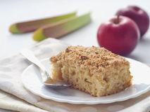 Rhubarb and strawberry crumble pie. Homemade biscuit cake decorated with crumbs. Summer fruits cake. Stock Photo