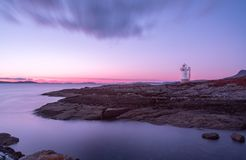 Rhue Lighthouse at Sunset. The Rhue lighthouse which is not far from the town of Ullapool in Ross Scotland. Picturesque during morning and sunset stock photos