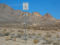 Rhyolite in Death Valley Nevada USA. View of the ghost town of Rhyolite in Death Valley Nevada USA with discharge of firearms prohibited sign Stock Photo