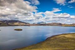 Rhyolitic mountains surround  lake Stock Photo