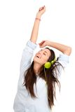 In the rhythm with headphones. Young woman dancing in the rhythm with headphones.Isolated Royalty Free Stock Images