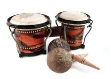 Rhythm instruments. Rhythm percussion instruments like maracas and bongo drums on a white background Stock Photo