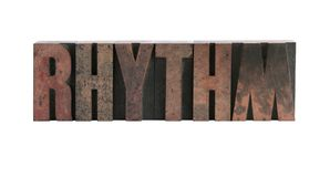 Rhythm in letterpress wood type. The word 'rhythm' in ink-stained wood letters isolated on white Royalty Free Stock Photo