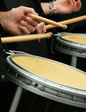 Rhythm of the rain. Snare drummer's hands, sticks and drum in a marching pipe band on a wet day stock image