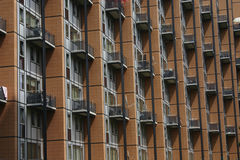 A rhythm of the rows of balconies of a modern building 1 Stock Photos