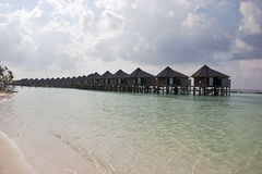 Rhythm of small houses on water. Indian ocean Royalty Free Stock Photo