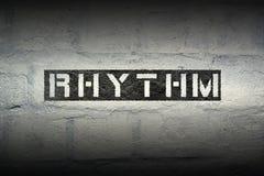 Rhythm word gr. Rhythm word stencil print on the grunge white brick wall Stock Photos