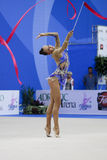Rhythmic gymnast Daria Dmitrieva Pesaro WC 2010. During the rhythmic gymnastic World Cup 2010, on August 28th, Senior Daria Dmitrieva of Russia performs with Royalty Free Stock Photos