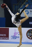 Rhythmic gymnast Daria Svatkovskaya Pesaro WC 2010. During the rhythmic gymnastic World Cup 2010, on August 29th, Junior Daria Svatkovskaya of Russia performs Royalty Free Stock Photo