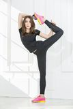 Rhythmic gymnast doing exercise in studio Royalty Free Stock Images
