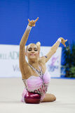 Rhythmic gymnast Evgeniya Kanaeva WC Pesaro 2010. During the rhythmic gymnastic World Cup 2010, on August 28th, Senior Evgeniya Kanaeva of Russia performs with Stock Image