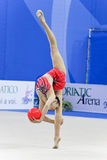 Rhythmic gymnast Senyue Deng Pesaro WC 2010. During the rhythmic gymnastic World Cup 2010, on August 28th, Senior Senyue Deng of China performs with ball in the royalty free stock photography