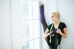Rhythmic gymnast in the studio Stock Images