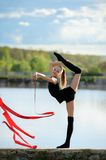 Rhythmic Gymnast in Vertical Split with Ribbon Stock Photography