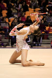 RHYTHMIC GYMNASTIC. Italian National Championship in Desio (MI) - Italy, 7th, November, 2009 The athlete in the photo is VALERIA SCHIAVI, performing with clubs Stock Image