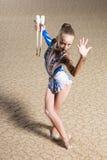 Rhythmic gymnastics. 12 years old girl doing rhythmic gymnastics royalty free stock photography