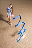 Rhythmic gymnastics. 12 years old girl doing rhythmic gymnastics stock photo