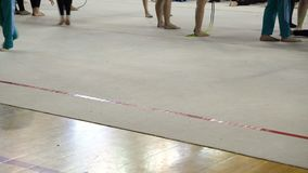 Rhythmic gymnastics, athletes warm up before the competition stock video