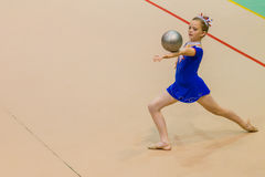 Rhythmic Gymnastics Girl Ball Balance Royalty Free Stock Images