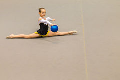 Rhythmic Gymnastics Girl Ball Control Splits Stock Image