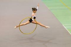 Rhythmic Gymnastics Girl Hoop Flight Stock Image