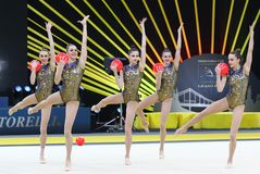 Rhythmic Gymnastics Grand Prix in Kyiv, Ukraine. KYIV, UKRAINE - MARCH 16, 2019: Team of UKRAINE performs with 5 Balls during Group Competition of Rhythmic royalty free stock photography