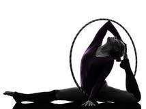Rhythmic Gymnastics with hula hoop woman silhouette. One caucasian woman exercising Rhythmic Gymnastics hula hoop in silhouette studio on white background royalty free stock image