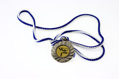 Rhythmic gymnastics medal. Rhythmic gymnastics medal on color background Stock Photo