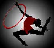 Rhythmic gymnastics. Ring. Gymnastics woman silhouette. Rhythmic gymnastics with ring. Gymnast woman flying in split. Background with gradient gray. The gymnast Stock Photography