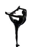 Rhythmic Gymnastics teeenager girl silhouette. One caucasian woman exercising Rhythmic Gymnastics in silhouette isolated on white background stock image