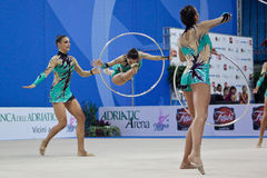 Rhythmic gymnasts Italy World Cup Pesaro 2010. During the rhythmic gymnastic World Cup 2010, on August 28th, The team of Italy performs the 5 hoops routine in Stock Image