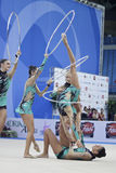 Rhythmic gymnasts Italy World Cup Pesaro 2010. During the rhythmic gymnastic World Cup 2010, on August 28th, The team of Italy performs the 5 hoops routine in stock photography