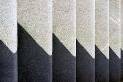 Rhythmic shadow on the steps of a sunny day Stock Image