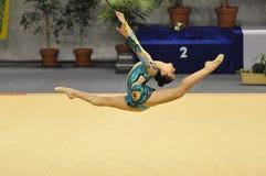 Rhythmisches gymnastisches, korallenrotes Kremer Stockfotografie