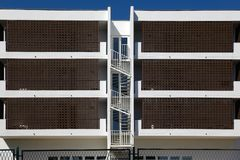 Rhythms of city architecture. Cottage apartments for rent symmetric view royalty free stock images