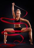 Rhytmic gymnast with ribbon Stock Photo