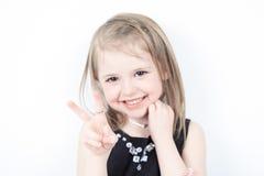 Ria uma menina no tiro do estúdio Foto de Stock Royalty Free